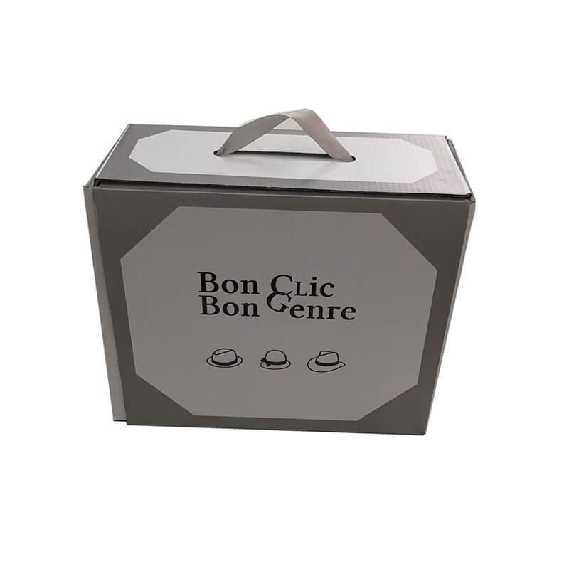 Flexo printed carton box with plastic handle